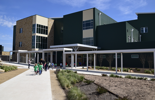 Elementary students walking into new learning center.