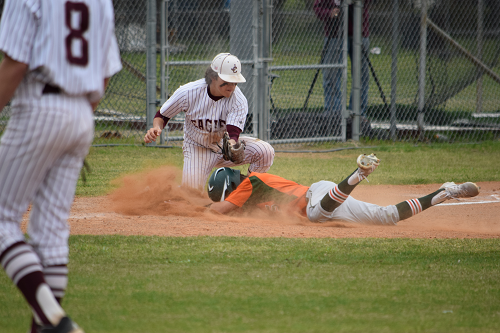 Gateway player sides head first into third base.
