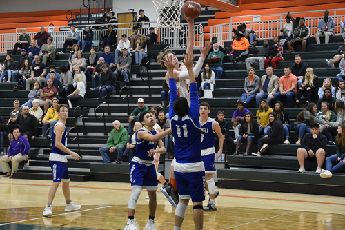 Justin Hinson goes up for shot over Jarrell defenders.
