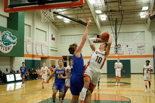 Ethan Miller shoots a layup against Blanco