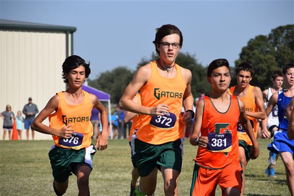 Three male cross country runners at Rogers Meet