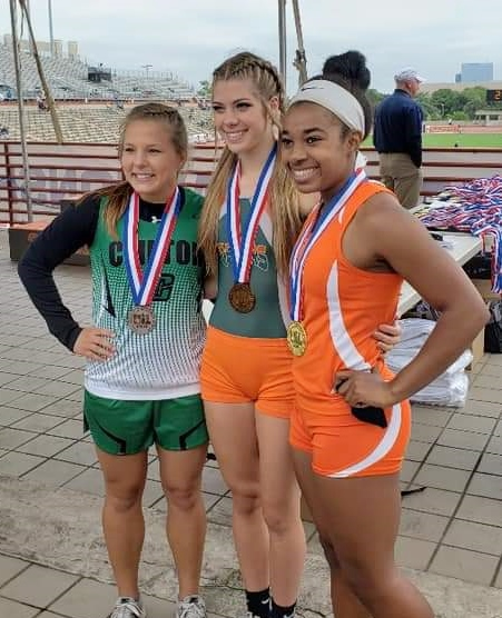Madi Gawthorp stands between other track medalists.