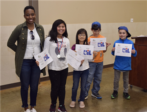 Teacher and four students holding their UIL certificates.