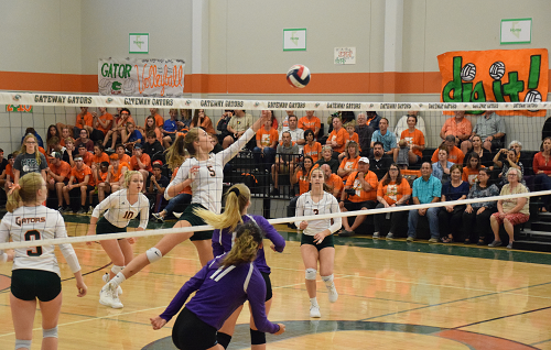 Kailyn Webb hits a shot over the net vs. Florence
