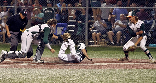 Catcher Taylor Smith tags a runner out at home plate.