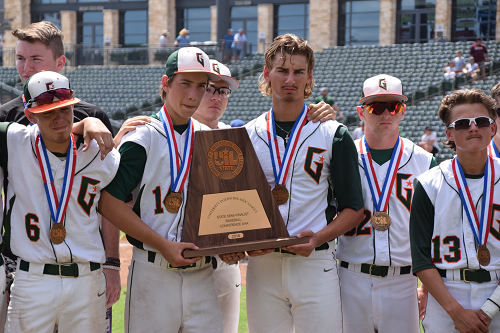Gator players hold UIL trophy at the end of their game.