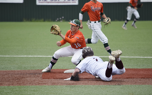 Gator second baseman tags out opposing player at second base.