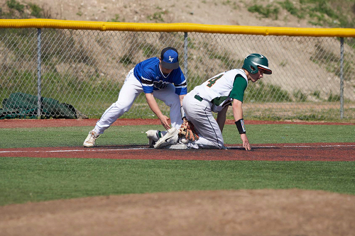 Gator player slides into second base.