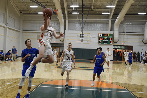 Nick Chalman goes up for a layup against Bartlett defender.