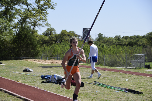 Gawthorp runs down the pole vault runway.