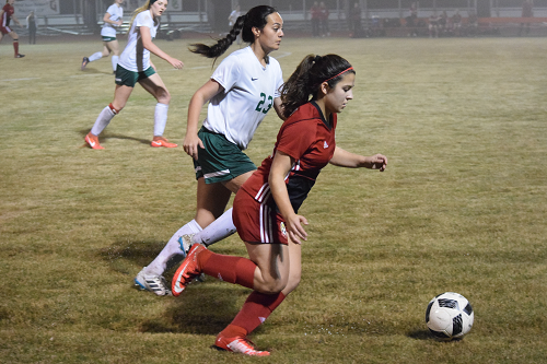 Salado player pushes the ball past a Gator defender.