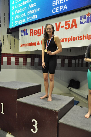 Lauren Chaney stands on the swim podium.
