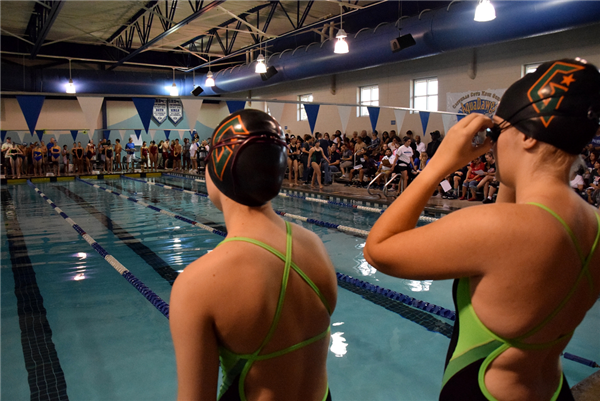 two female swimmers get ready for race