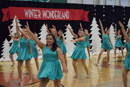 Dance Team performing in turquoise outfits.