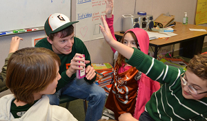 Baseball player with flash cards in elementary class.